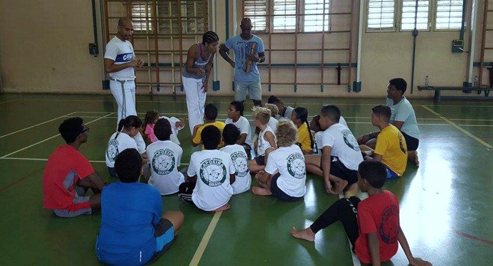 post_curacao_capoeira_teaching_a_song