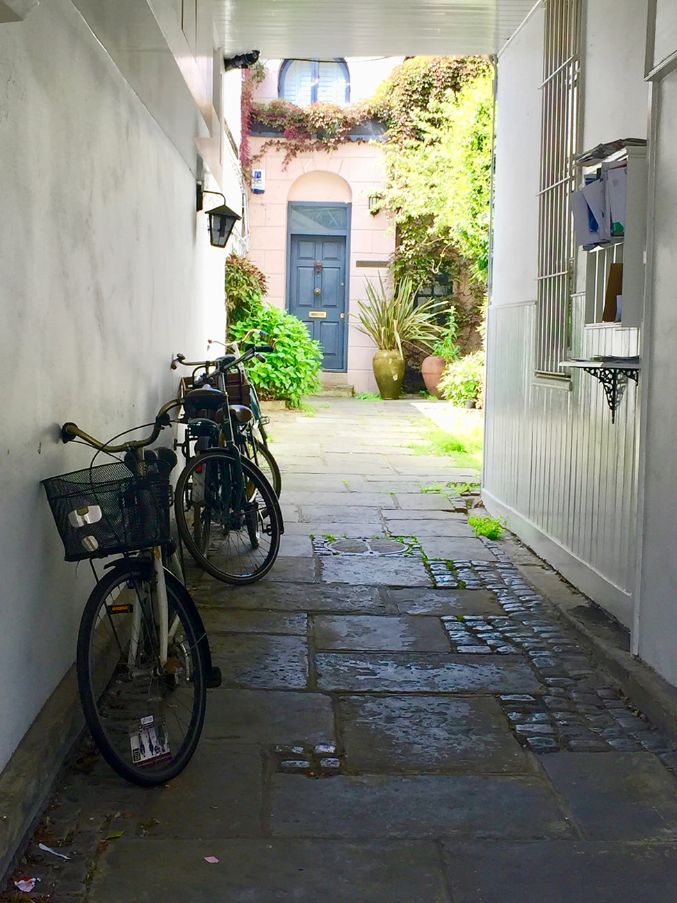 Bicycles and blue door in a London mews