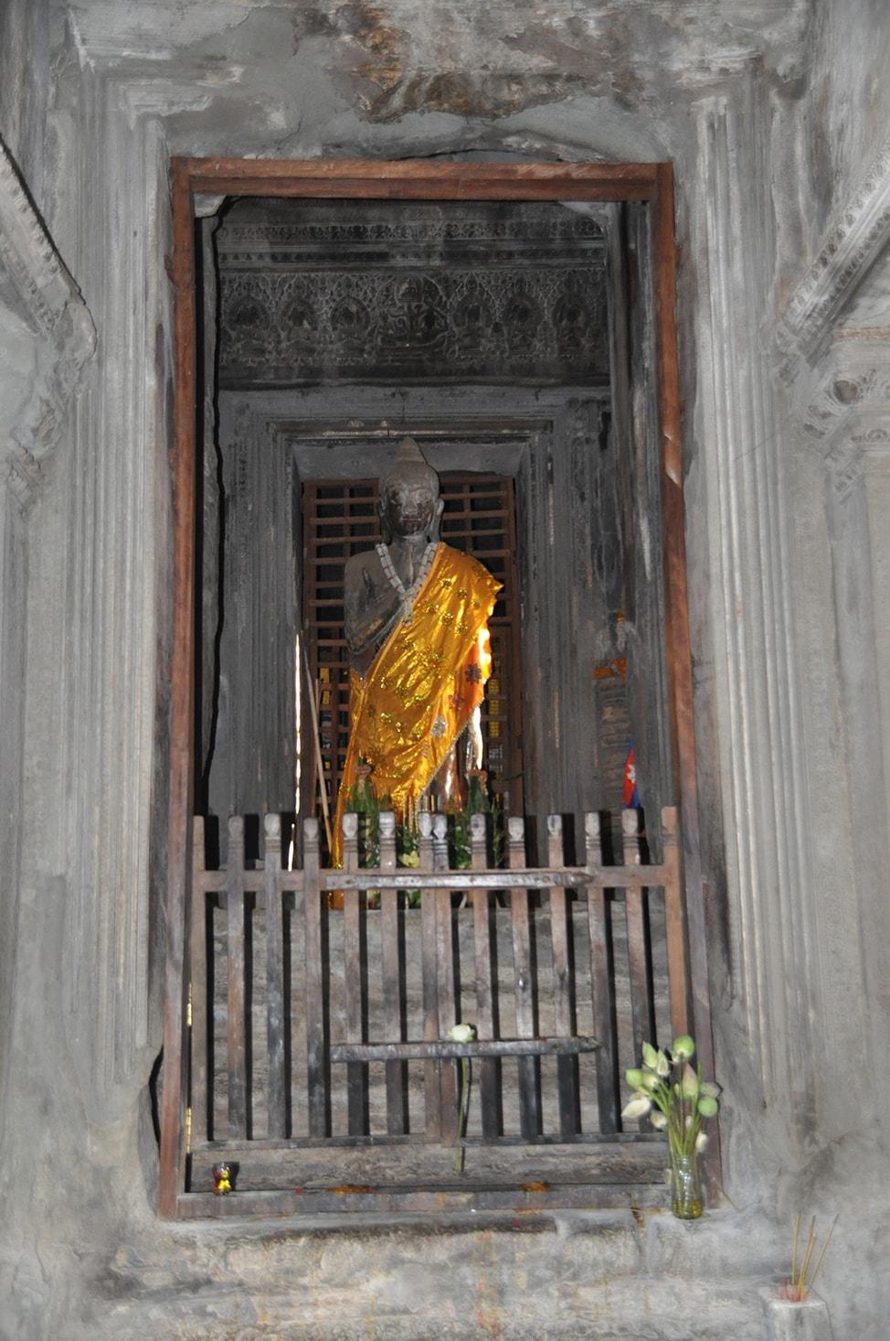 Image of Buddha statue draped in gold fabric
