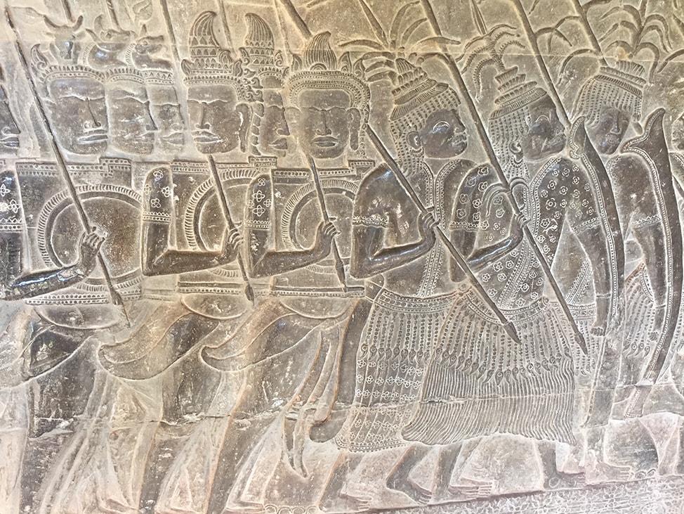 Carving at Angkor Wat of Cambodian and Thai warriors