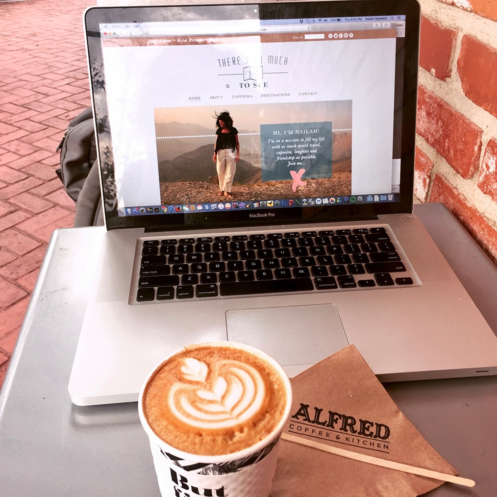 My laptop and a cappuccino at a cafe in Los Angeles