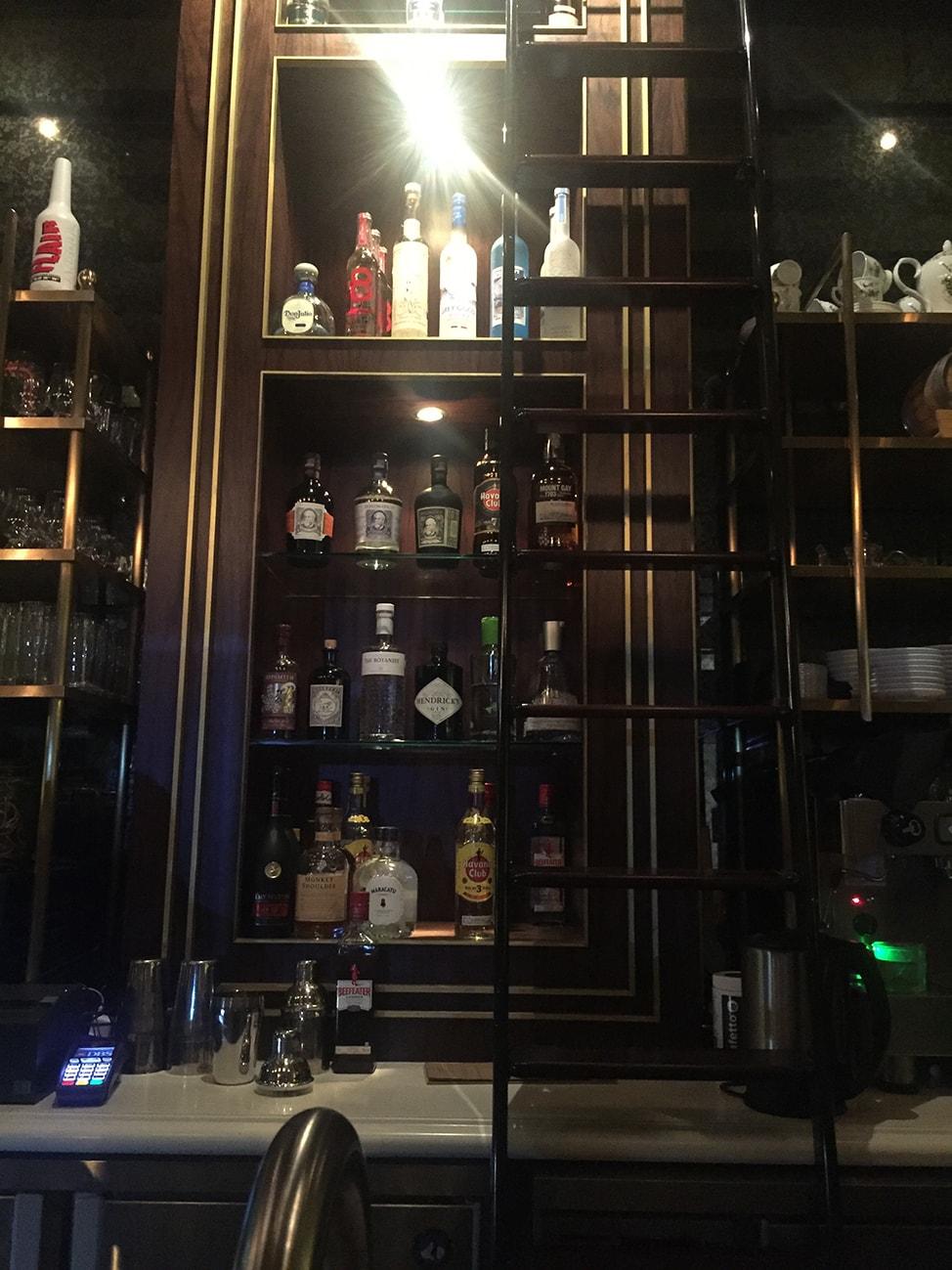The dark wood bar at The Fat Prince