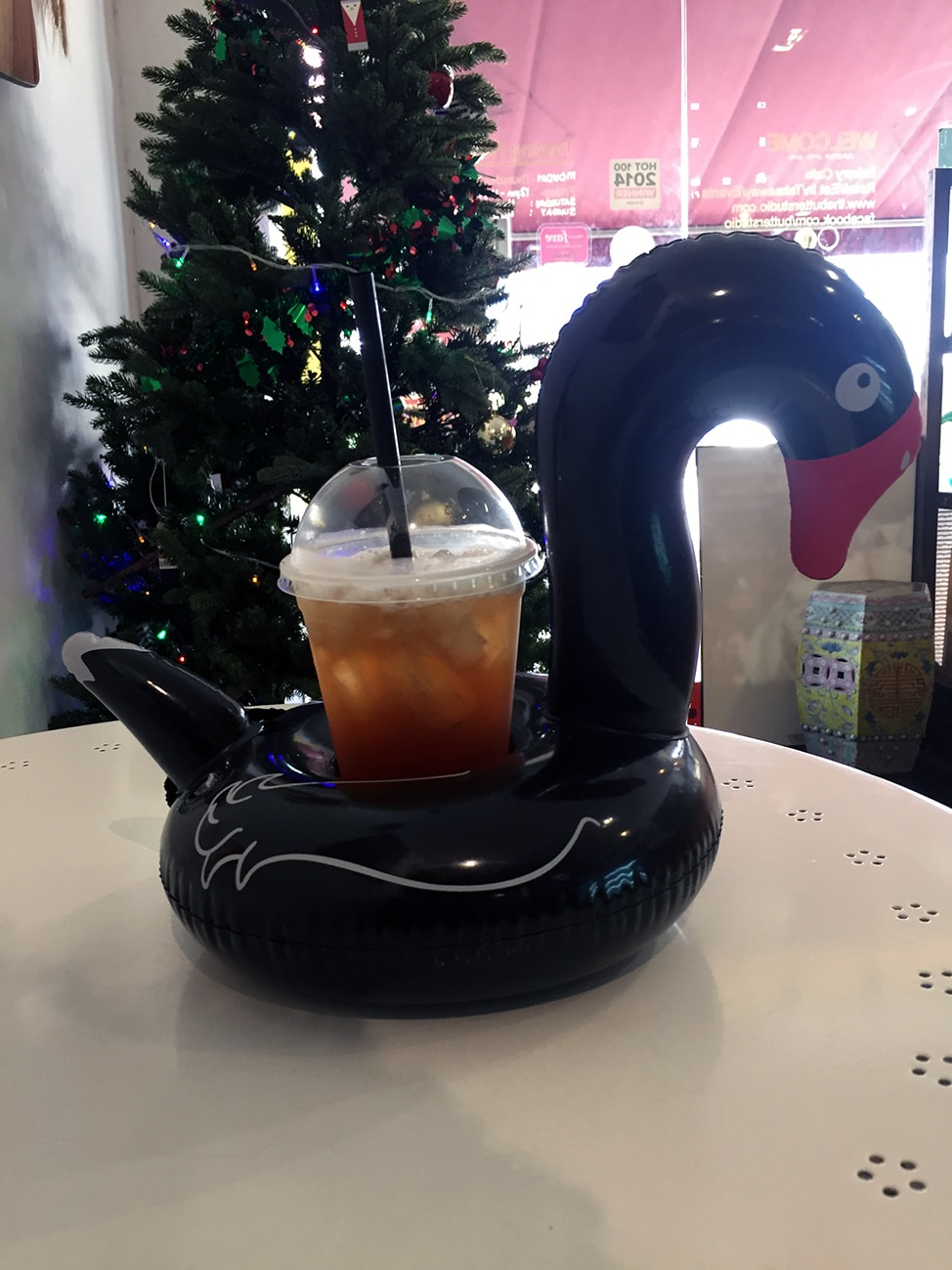 Iced tea served with an inflatable black swan.